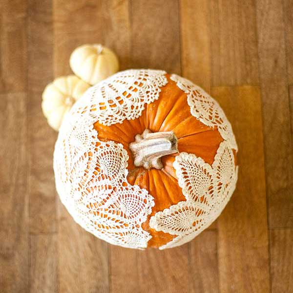 pumpkin with starched doilies, painted pumkin carving alternative