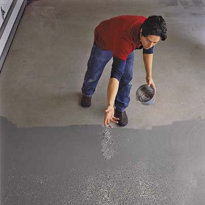Apply the color flakes by sprinkling them lightly onto the epoxy-coated garage floor