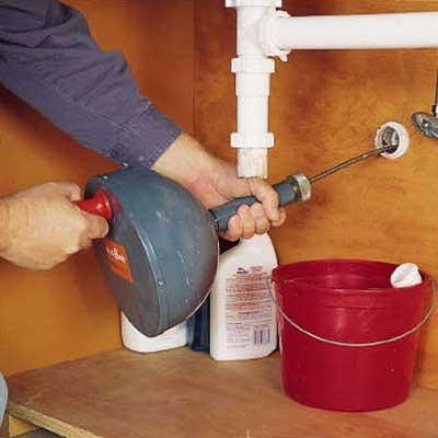 repairing a clogged sink