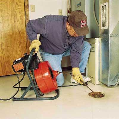 repairing a clogged floor drain