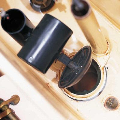 worn flapper valve in toilet tank
