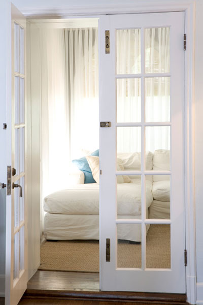 pale violet french doors leading into a sitting room, with one of the doors open