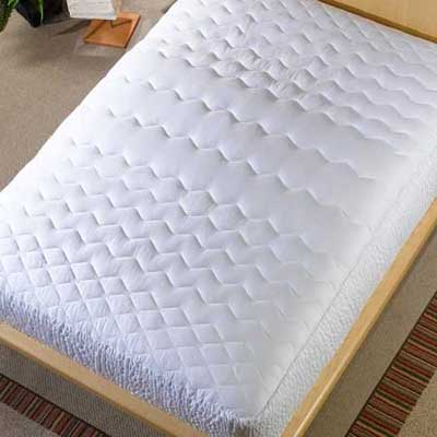 mattress on an unmade bed