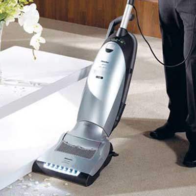 vacuum in use cleaning a carpet