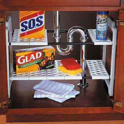 a collection of cleaning materials below a sink