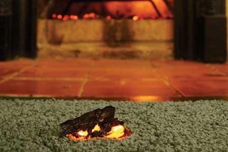 fireplace ember on carpet