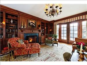The                                                          wood-paneled                                                          library with                                                          fireplace.
