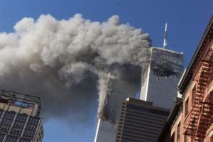 This Sept. 11, 2001 file photo shows smoke rising from the burning twin towers of the World Trade Center after hijacked planes crashed into the towers, in New York City.