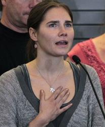 This Oct. 4, 2011 photo shows Amanda Knox speaking at a news conference shortly after her arrival at Seattle-Tacoma International Airport in Seattle.