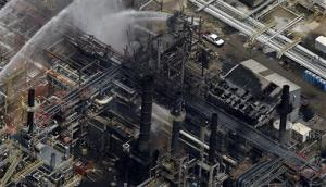 A chemical plant near Baton Rouge is hosed down after the morning explosion and fire.