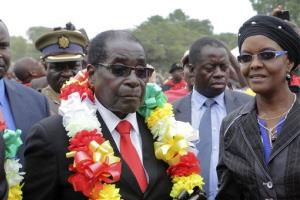 Zimbabwe's President Robert Mugabe,left, and his wife Grace arrive for celebrations to mark his 90th birthday in Marondera, east of  Harare, Sunday, Feb. 23, 2014. In July, Mugabe who has ruled the nation for 33 years since 1980, won disputed elections for another five-year term that will take him...