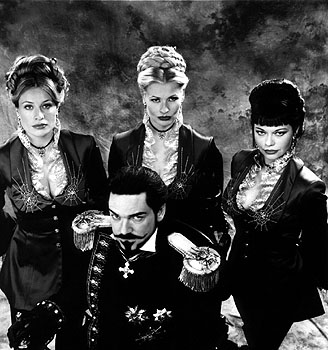Kenneth Branagh, flanked by Frederique Van Der Wal, Sofia Eng and Musetta Vander in Warner Brother's Wild Wild West - 1999