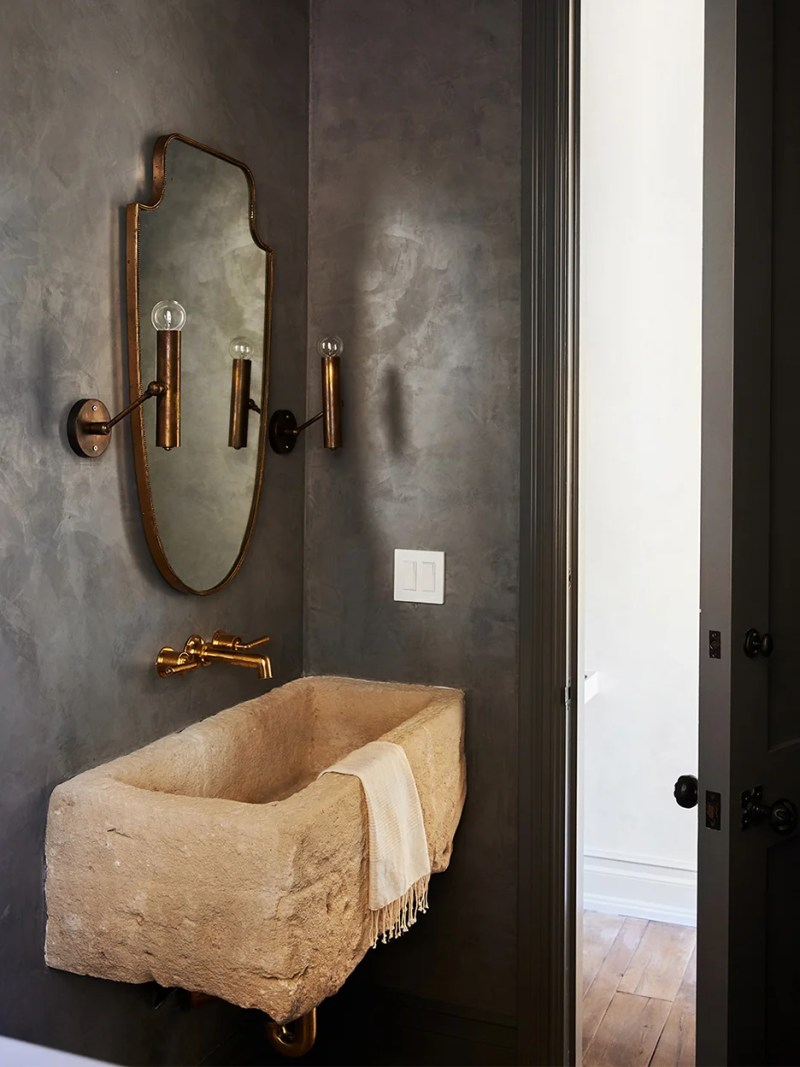 black bathroom walls and sand colored sink