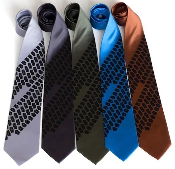 Tread Lightly tie. Tire track silkscreened microfiber necktie.