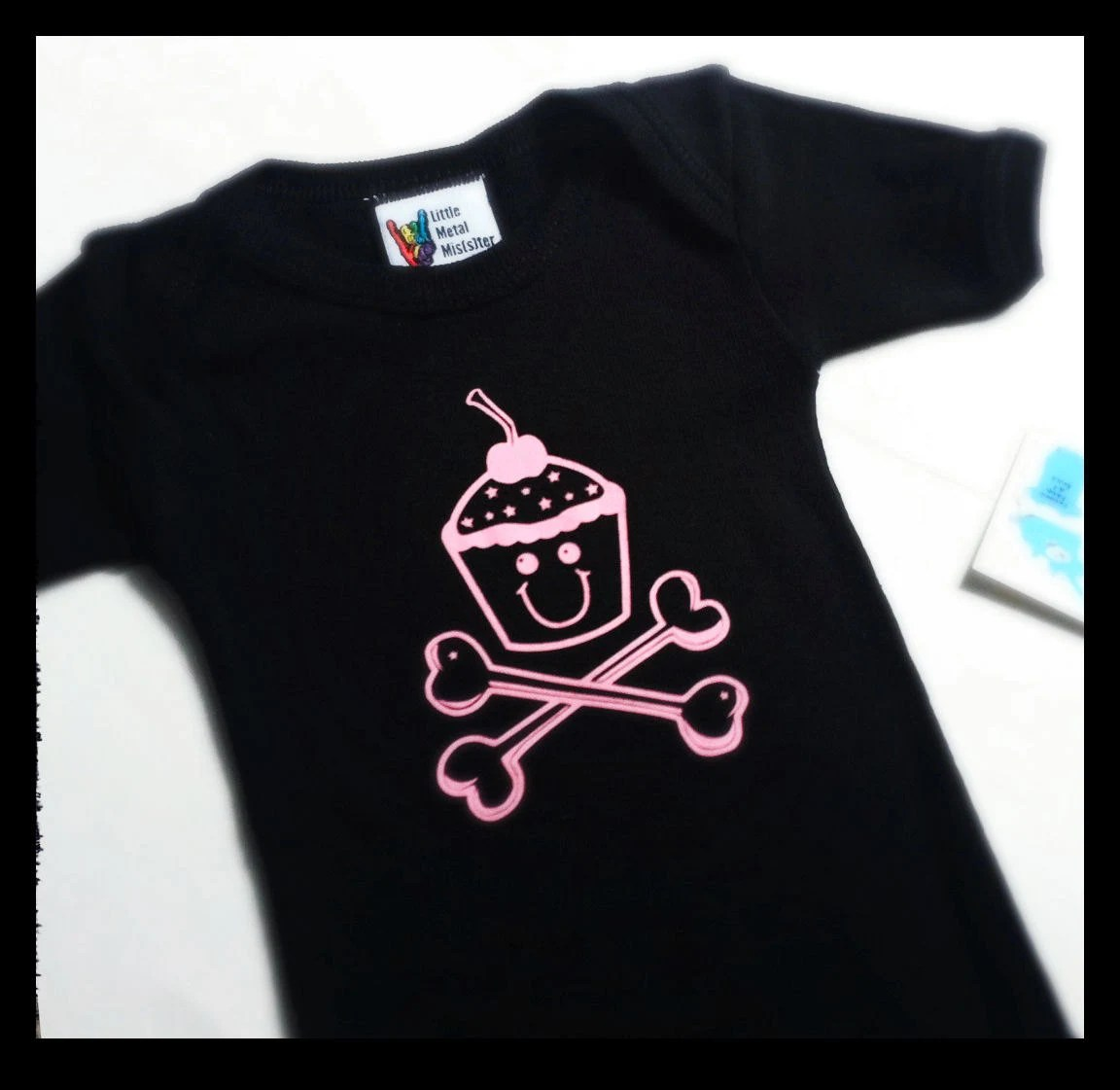 Cupcakes & Crossbones 6 months -- adorable for punk rock / heavy metal family with baby girl. Black and pink onesie