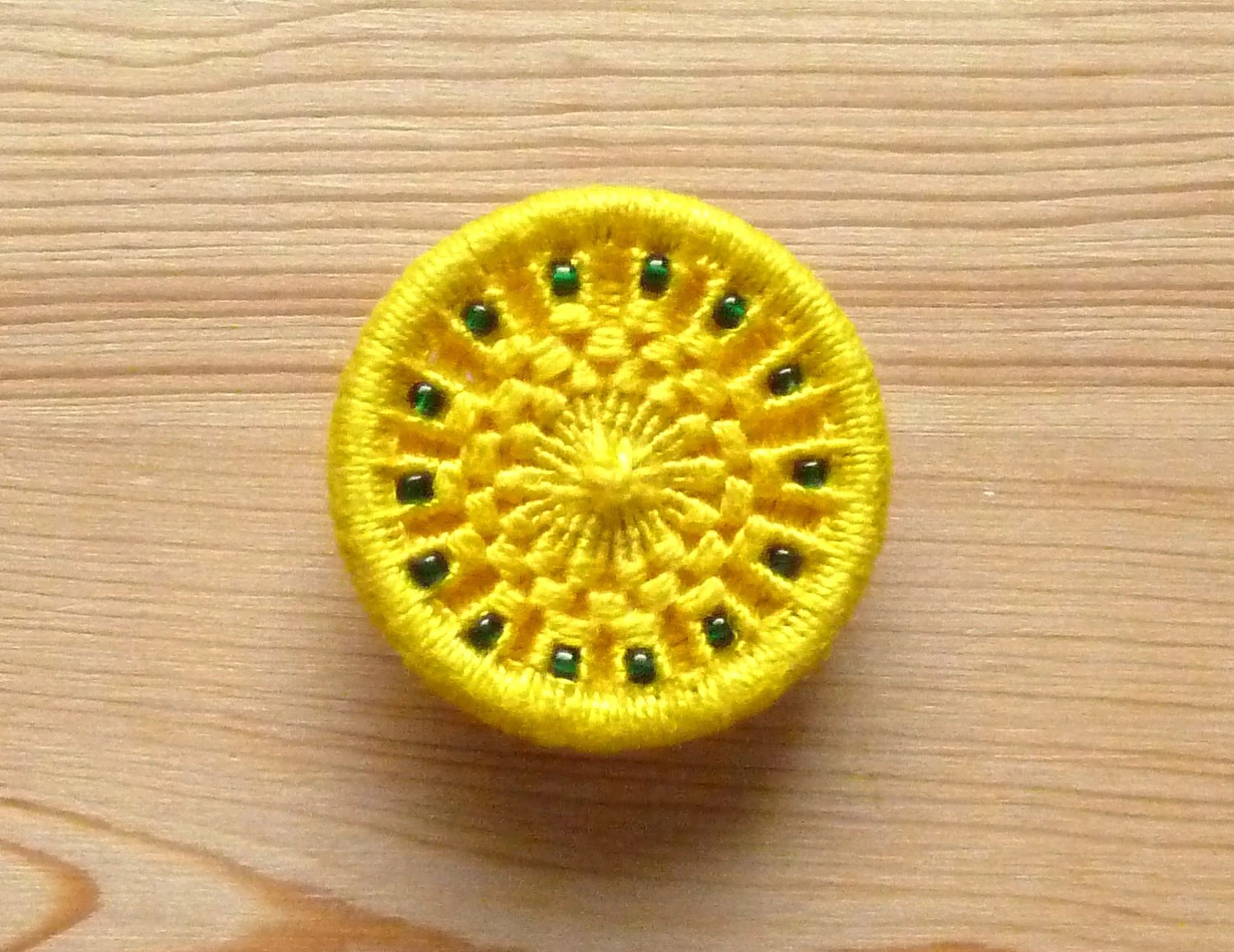 yellow green brooch -- Dorset button brooch in yellow with green beads, badge hand woven