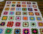 Handmade crochet blanket -  Made in tradition granny multi colour style with white border   673