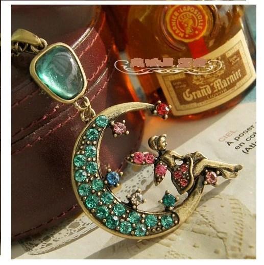 retro brass tone blue rhinestone crescent moon pink rhinestone fairy genius pendant delicate childhood memory peter pan