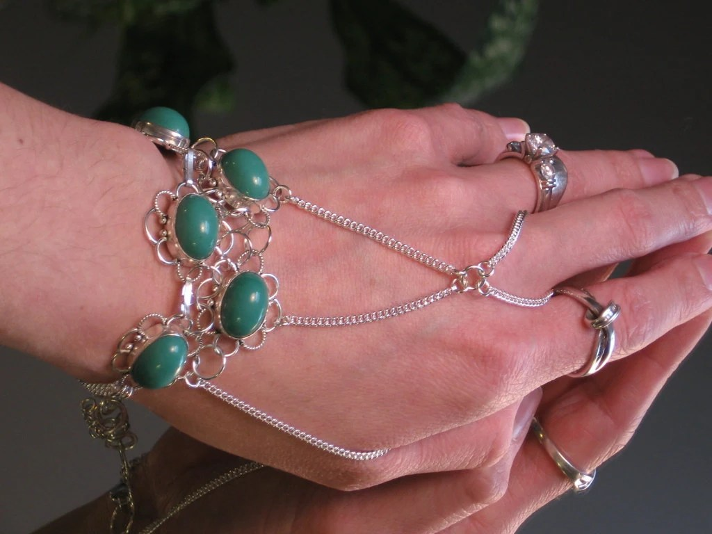 Turquoise Gemstone Slave Bracelet Ring. Silver Flower charms with Turquoise Gemstones. 925 Sterling Silver Flat Chain. Adjustable.