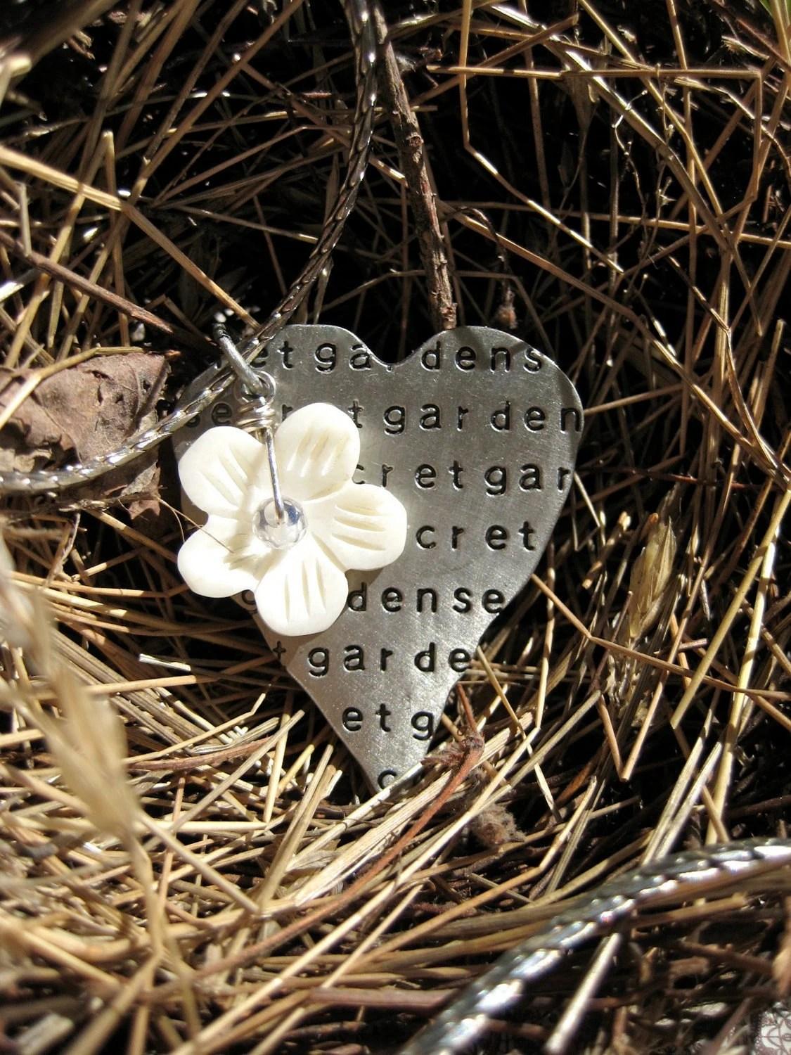 The Secret Garden. Etched heart charm with flower, long necklace