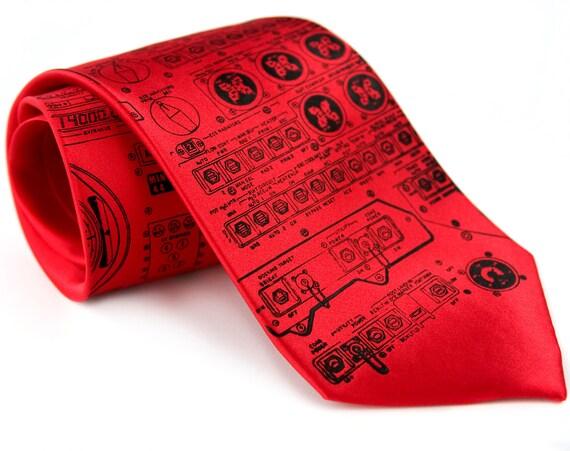 Rocket Science red silk necktie. As worn by astronaut Al Worden, Apollo 15. Apollo cockpit silkscreened tie. Black ink.