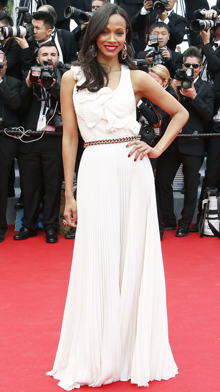 Zoe Saldana poses as she arrives for the Opening ceremony of the 67th edition of the Cannes Film Festival on May 14, 2014