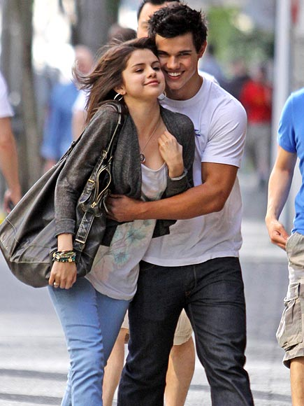 14. HE DOESN'T KISS & TELL photo | Selena Gomez, Taylor Lautner