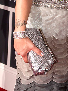 Jeweled Judith Leiber clutch and Neil Lane diamond bracelet