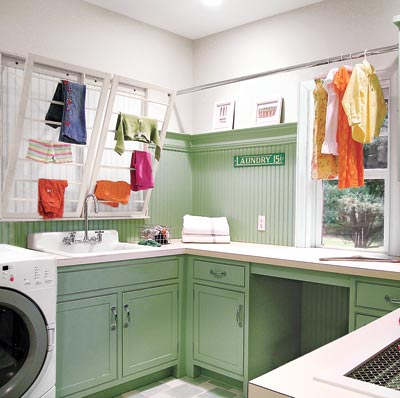 bright and spacious laundry room with storage