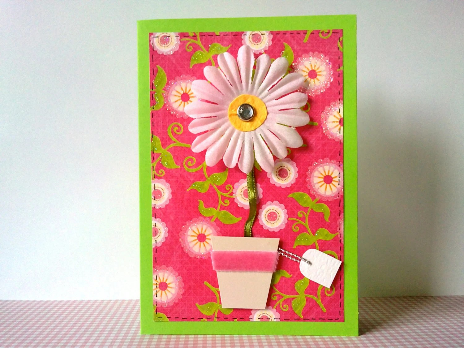 Bright pink and green daisy greeting card