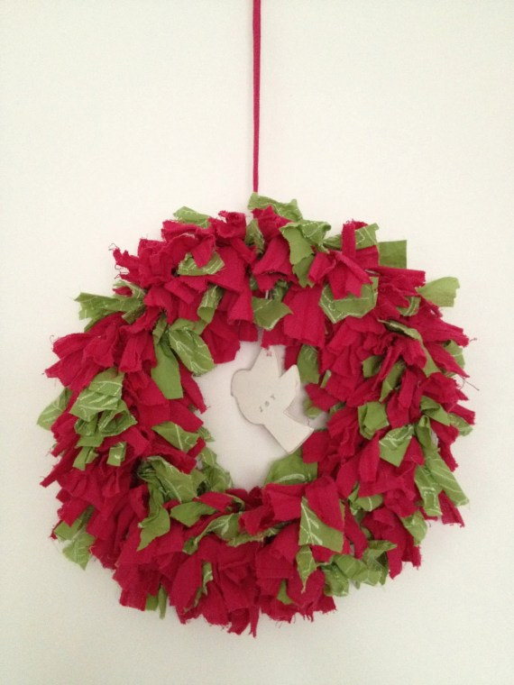 fuschia pink and green rag wreath, with a hanging wooden dove. - NancyLoves