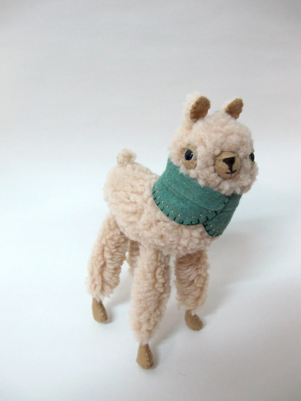 Small Wooly Alpaca in a Leaf Green Embroidered Cape