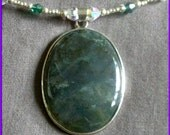 sterling moss agate pendant on green and white swarovski crystal, CZ, and silver beaded memory wire necklace