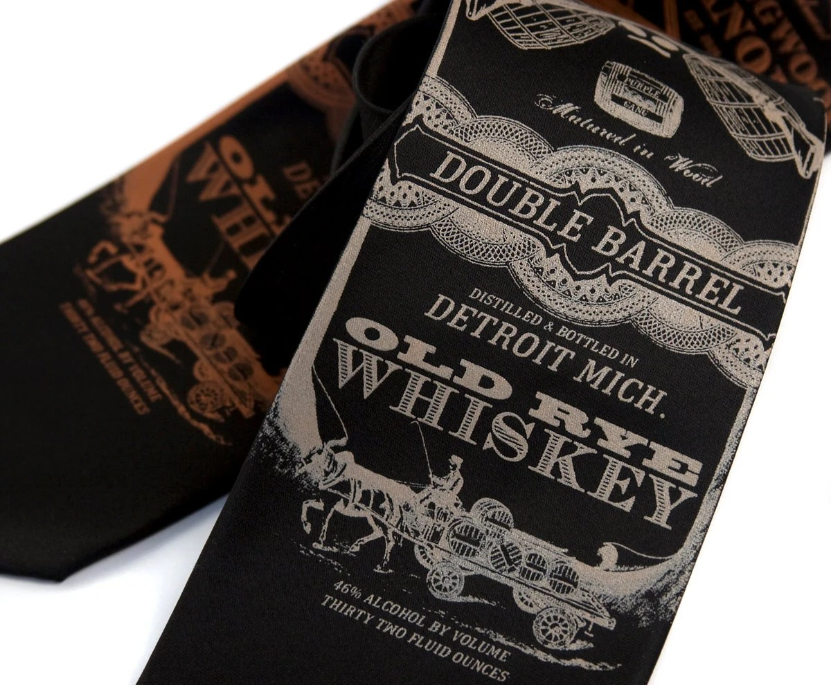 "Black ""Whiskey Business"" necktie. Silkscreened microfiber. Choose tan or muted orange print."