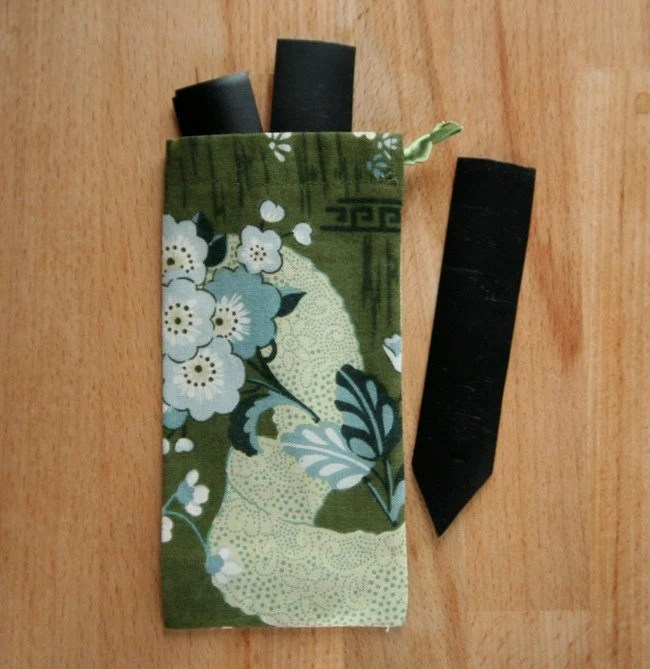 Upcycled seedling labels with fabric pouch in green