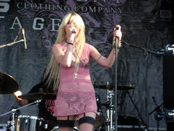 Taylor Momsen showing panties and bra performing in sheer pinkish dress at Vans Warped Tour in Pomona - Hot Celebs Home