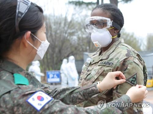 South Korean and American service members prepare for joint disinfection work against the new coronavirus in South Korea's southern city of Daegu on March 27, 2020, in this photo provided by the Korean Army. (PHOTO NOT FOR SALE) (Yonhap)