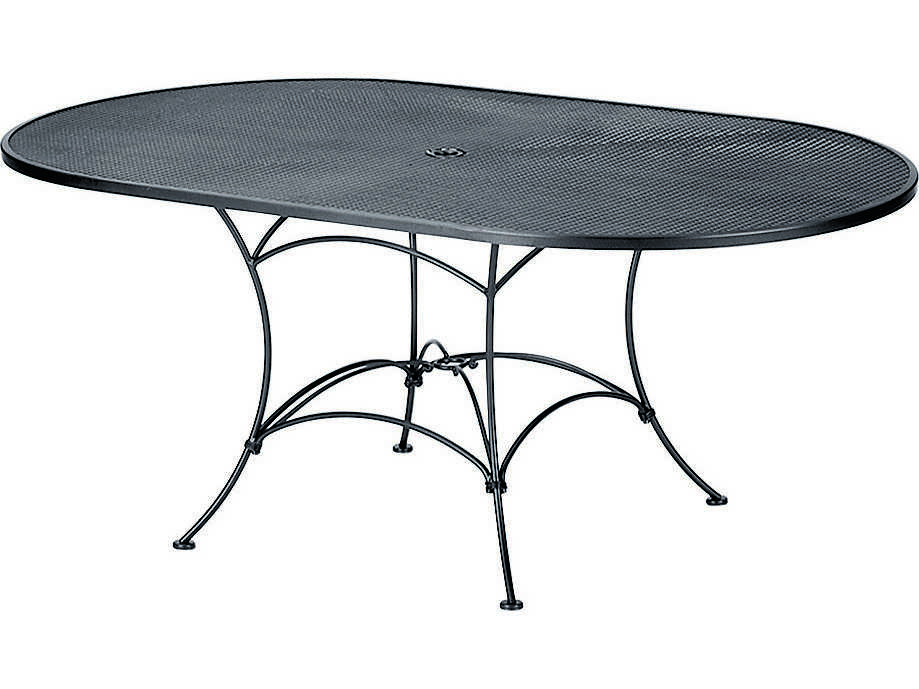 woodard wrought iron mesh 72 w x 42 d oval dining table with umbrella hole