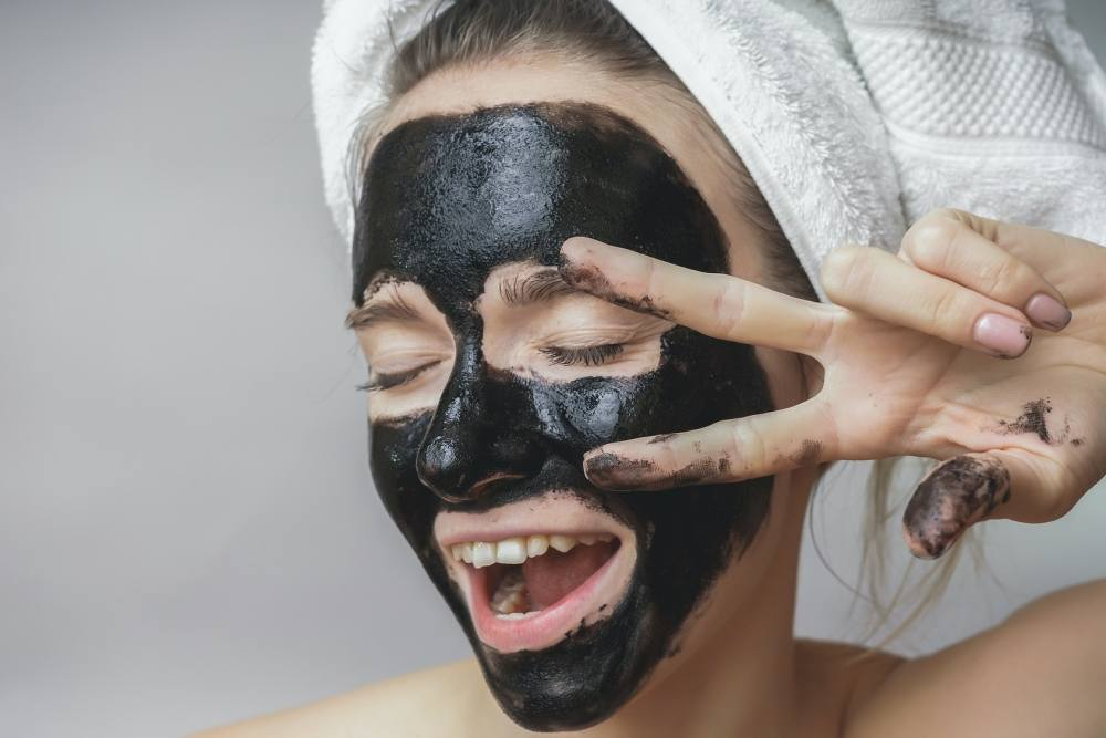Image result wey dey for how charcoal treat acne?