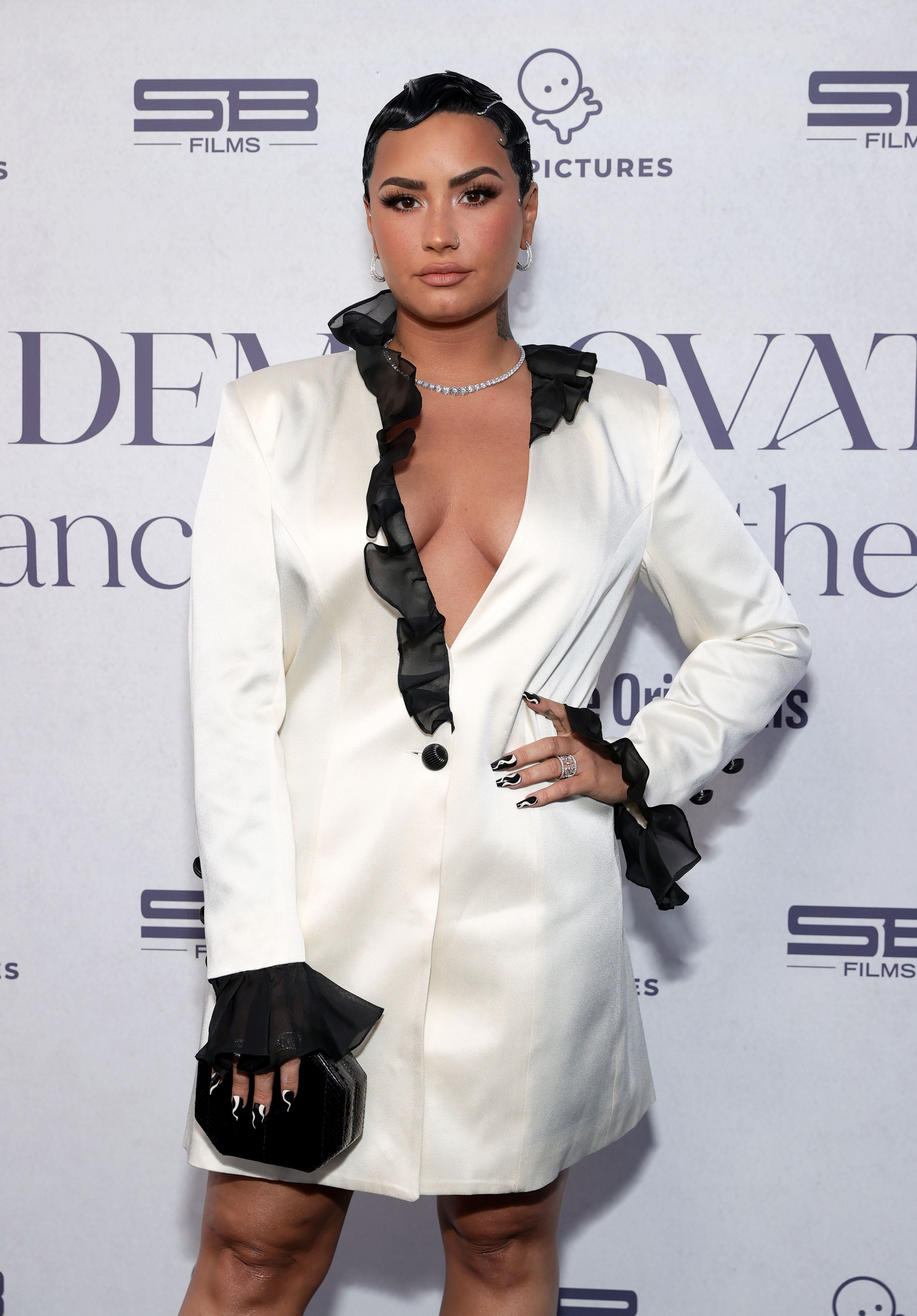 Celebrity Leo Demi Lovato shows off his style at a red carpet event.