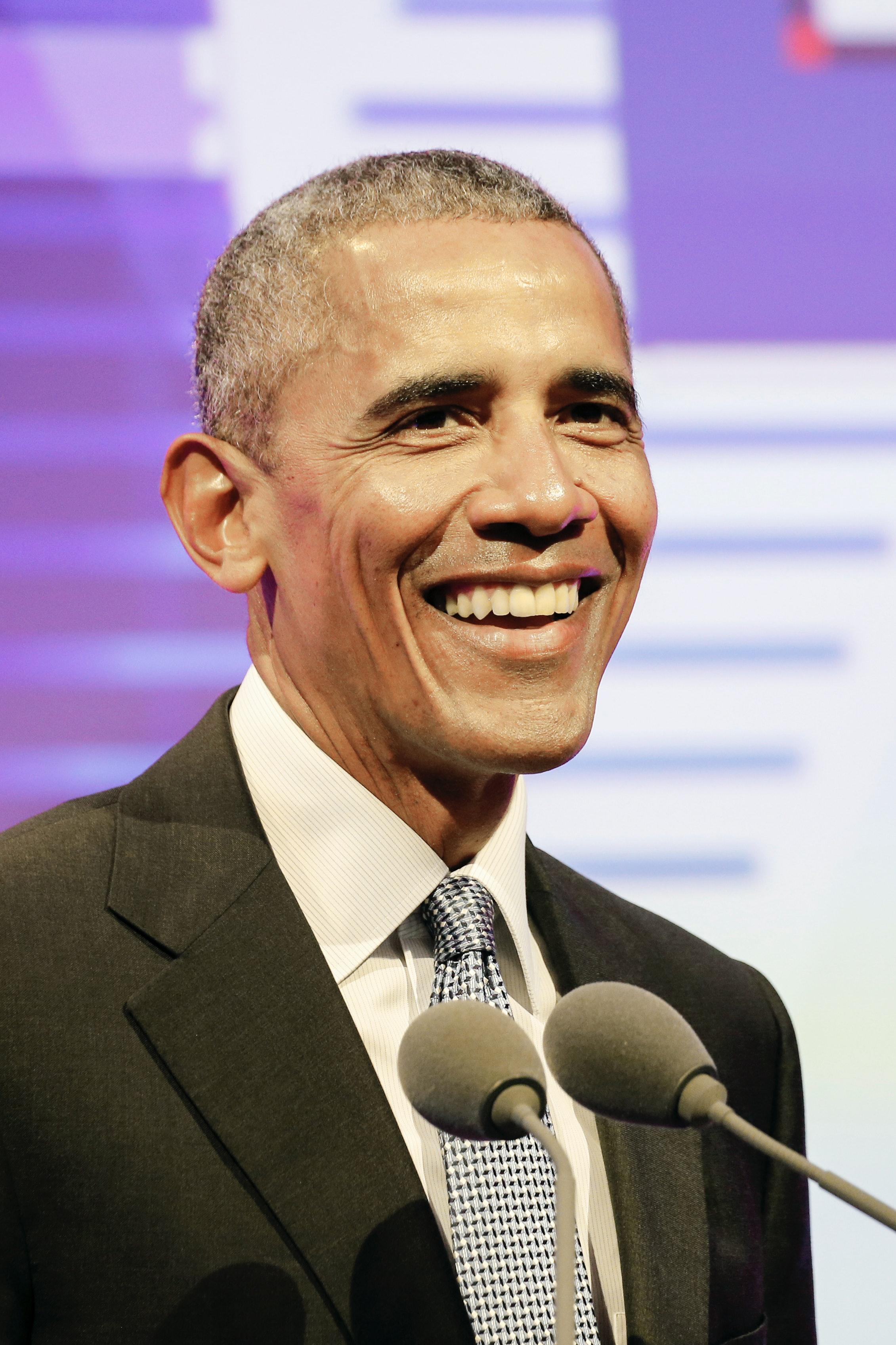 Celebrity Leo and former US President Barack Obama attend a media event.