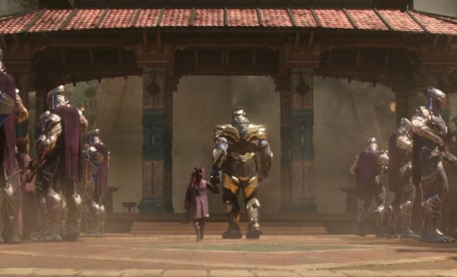 Thanos, in golden armor, and Gamora as a child, holding hands as Thanos leads Gamora to a pavillion. Thanos is gigantic, and the young, red-haired Gamora's head is roughly at waist level.