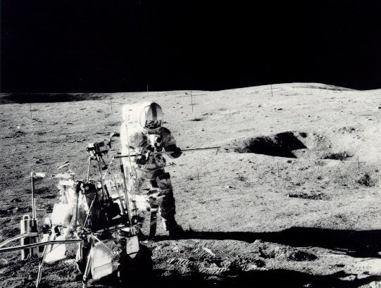 Apollo 14 astronaut Alan Shepard conducts a scientific experiment on the Moon