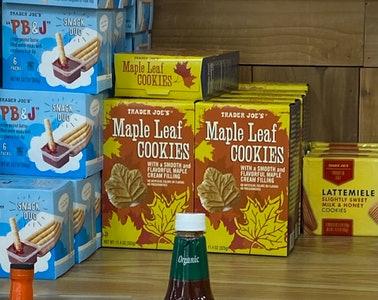 An image of four boxes of maple cream leaf cookies.