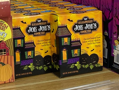 Boxes of Halloween cookies on a shelf.