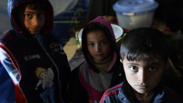 31-köpfige Familie kämpft um Asyl in Deutschland (Bild: APA/ROBERT JAEGER)