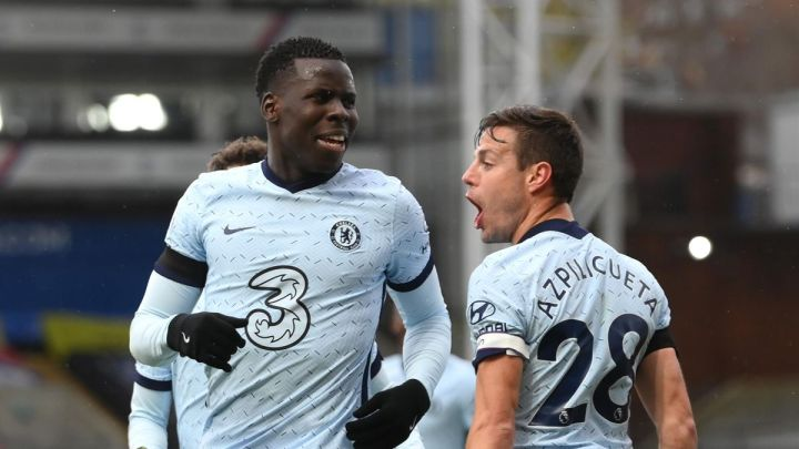 Kurt Zouma of Chelsea celebrates with Cesar Azpilicueta after scoring their team's third goal during the Premier League match between Crystal Palace and Chelsea at Selhurst Park on April 10, 2021 in London, England.