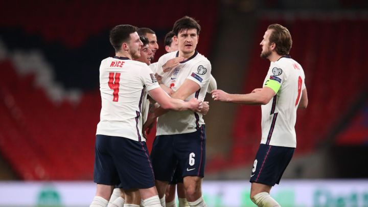 Harry Maguire of England celebrates with Declan Rice and Harry Kane after scoring their side's second goal during the FIFA World Cup 2022 Qatar qualifying match between England and Poland on March 31, 2021 at Wembley Stadium