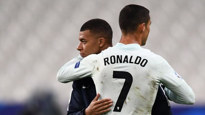 Portugal's forward Cristiano Ronaldo (R) embraces France's forward Kylian Mbappe at the end of the Nations League football match between France and Portugal, on October 11, 2020 at the Stade de France in Saint-Denis, outside Paris