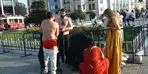 Taksim Meydanı'nda şaşkına çeviren görüntü! Herkesin önünde soyundular